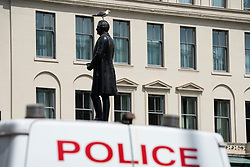 Glasgow, Scotland, UK. 12 June 2020. Police patrol George Square in the city centre to prevent vandalism to the many historic statues located here. Following the recent Black Lives Matter demonstrations in the UK,  many colonial era statues have been targeted by protestors. Pic; Robert Peel statue is thought to be prime target.  Iain Masterton/Alamy Live News