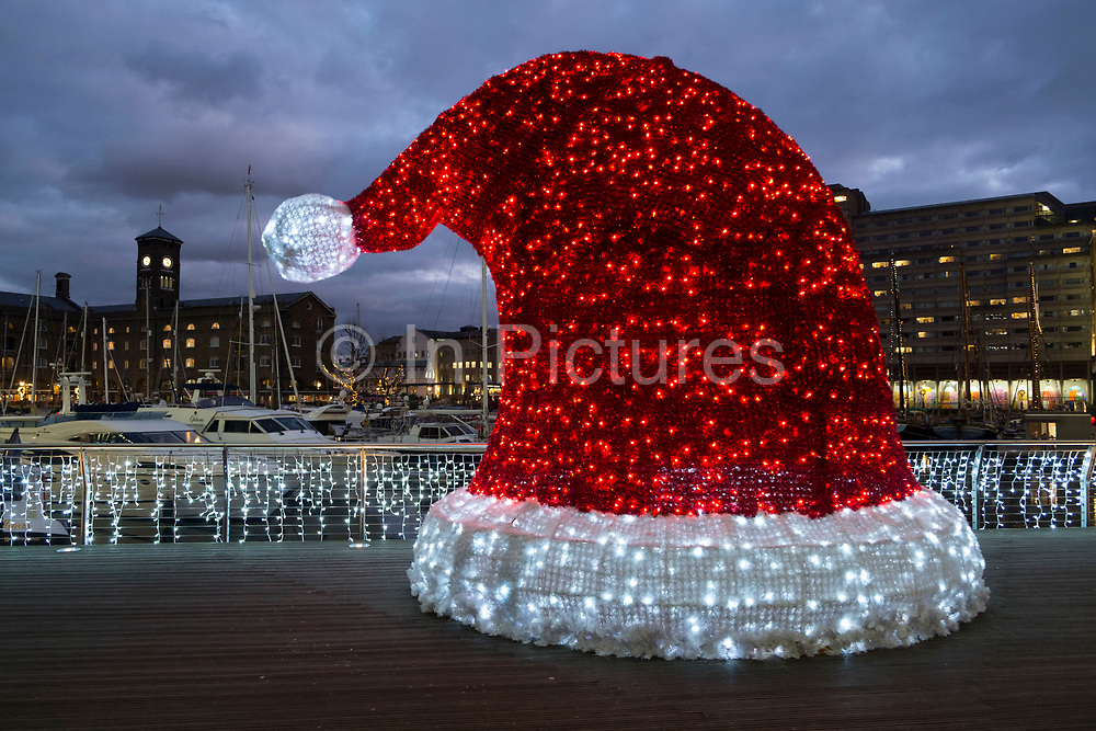 Father Christmas red hat Christmas decorations at St Katherine Docks in London, England, United Kingdom.