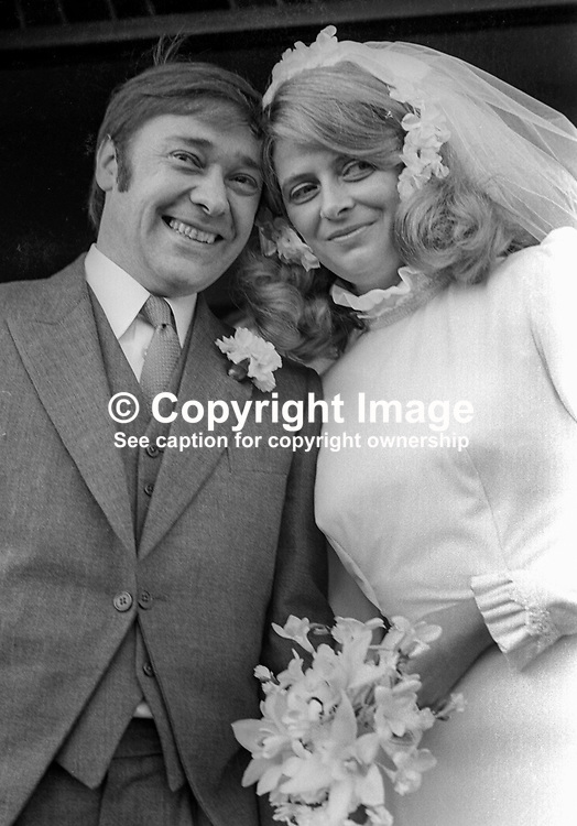 Bob Cooper, deputy leader, Alliance Party of N Ireland, with his bride, Patricia Nicholl after their wedding in St Brigid's RC Church, Derryvolgie Avenue, Belfast, on 2nd November 1974. 197411020602b<br /> <br /> Copyright Image from Victor Patterson,<br /> 54 Dorchester Park, <br /> Belfast, UK, BT9 <br /> <br /> t1: +44 28 9066 1296 (from Rep of Ireland 048 90661296)<br /> t2: +44 28 9002 2446 (from Rep of Ireland 048 9002 2446)<br /> <br /> m: +44 7802 353836<br /> <br /> e: victorpatterson@me.com<br /> www.victorpatterson.com<br /> <br /> Please see my Terms and Conditions of Use at www.victorpatterson.com. It is IMPORTANT that you familiarise yourself with them.<br /> <br /> Images used on the Internet must be visibly watermarked i.e. © Victor Patterson<br /> within the body of the image and copyright metadata must not be deleted. Images <br /> used on the Internet have a size restriction of 4kbs and will be chargeable at current<br />  NUJ rates unless agreed otherwise.<br /> <br /> This image is only available for the use of the download recipient i.e. television station, newspaper, magazine, book publisher, etc, and must not be passed on to any third <br /> party. It is also downloaded on condition that each and every usage is notified within 7 days to victorpatterson@me.com<br /> <br /> The right of Victor Patterson to be identified as the author is asserted in accordance with The Copyright Designs And Patents Act (1988). All moral rights are asserted.