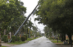 A fallen electric pole at 30th Street and 137th Avenue in Miami as the outer bands of Hurricane Irma reach South Florida early on Saturday, September 9, 2017. Photo by David Santiago/El Nuevo Herald/TNS/ABACAPRESS.COM
