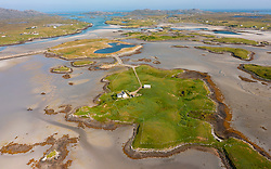 Aerial view from drone of  small islands on Oitir Mhor estuary on Benbecula in  the Outer Hebrides, Scotland, UK