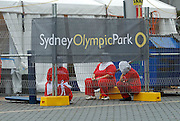 Workers at a fast-food tent having a break. Sydney Olympic Park, Sydney, Australia