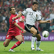 Turkey's Hamit ALTINTOP (L) and Germany's Mario GOMEZ (R) during their UEFA EURO 2012 Qualifying round Group A matchday 19 soccer match Turkey betwen Germany at TT Arena in Istanbul October 7, 2011. Photo by TURKPIX