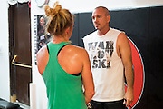 Coach Mike Winkeljohn visits with UFC bantamweight Holly Holm at Jackson Wink MMA in Albuquerque, New Mexico on June 9, 2016.
