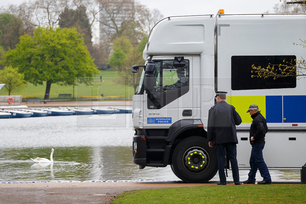 © licensed to London News Pictures. London, UK 07/04/2014. Police diver team getting ready as police officers searching the Serpentine in Hyde Park after a man in his 20s  feared drowned after taking a dip on Sunday afternoon of April 6, 2014. The lake has been cordoned off as the search continues on Monday, April 7, 2014. Photo credit: Tolga Akmen/LNP