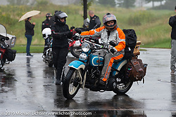 Jody Perewitz riding her 1936 Harley-Davidson through the rain during the Cross Country Chase motorcycle endurance run from Sault Sainte Marie, MI to Key West, FL (for vintage bikes from 1930-1948). Stage 3 from Milwaukee, WI to Urbana, IL. USA. Sunday, September 8, 2019. Photography ©2019 Michael Lichter.