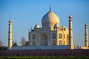 The Taj Mahal at sunset. It is an ivory-white marble mausoleum on the southern bank of the river Yamuna in the Indian city of Agra