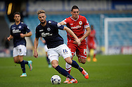 Mark Beevers of Millwall breaks away from Federico Macheda of Cardiff City (r). Skybet football league championship match , Millwall v Cardiff city at the Den in Millwall, London on Saturday 25th October 2014.<br /> pic by John Patrick Fletcher, Andrew Orchard sports photography.