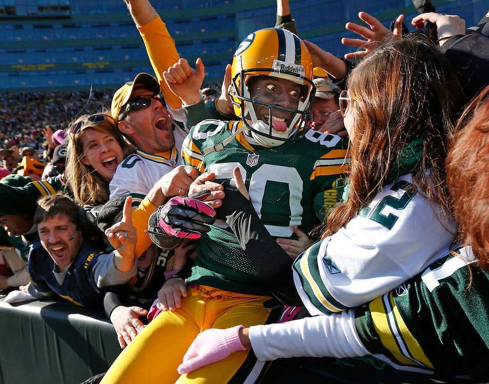 Green Bay Packers wide receiver Donald Driver celebrates a touchdown after doing a Lambeau Leap during the second half of an NFL football game Sunday, Oct. 28, 2012, in Green Bay, Wis.  The Packers won 25-15.