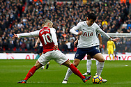 Son Heung-min of Tottenham Hotspur (R) in action with Jack Wilshere of Arsenal (L). Premier league match, Tottenham Hotspur v Arsenal at Wembley Stadium in London on Saturday 10th February 2018.<br /> pic by Steffan Bowen, Andrew Orchard sports photography.