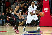 DALLAS, TX - FEBRUARY 6: Ryan Manuel #1 of the SMU Mustangs brings the ball up court against the Temple Owls on February 6, 2014 at Moody Coliseum in Dallas, Texas.  (Photo by Cooper Neill) *** Local Caption *** Ryan Manuel
