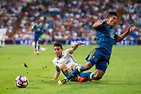 Real Madrid's player James Rodriguez and Celta de Vigo's player Sergi Gomez during a match of La Liga Santander at Santiago Bernabeu Stadium in Madrid. August 27, Spain. 2016. (ALTERPHOTOS/BorjaB.Hojas)
