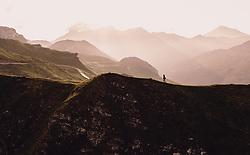 THEMENBILD - eine Wanderin in den Bergen am frühen Morgen nach Sonnenaufgang. Die Grossglockner Hochalpenstrasse verbindet die beiden Bundeslaender Salzburg und Kaernten und ist als Erlebnisstrasse vorrangig von touristischer Bedeutung, aufgenommen am 22. Juli 2019 in Fusch a. d. Grossglocknerstrasse, Österreich // a hiker in the mountains in the early morning after sunrise. The Grossglockner High Alpine Road connects the two provinces of Salzburg and Carinthia and is as an adventure road priority of tourist interest, Fusch a. d. Grossglocknerstrasse, Austria on 2019/07/22. EXPA Pictures © 2019, PhotoCredit: EXPA/ JFK