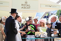 Winning jockey John Velazquez (centre) with The Duke of Cambridge (left), The Duchess of Cambridge (second left) and winning owner Wesley Ward (far right) after the King's Stand Stakes during day one of Royal Ascot at Ascot Racecourse.
