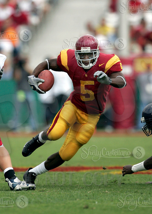 8 October 2005: USC Trojans #5 Reggie Bush running with the ball during a 42-21 win over the Arizona Wildcats at the Los Angeles Memorial Coliseum. NCAA Pac-10 College Football day game.