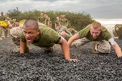 Recruits with Echo Company, 2nd Recruit Training Battalion, conduct warm-up exercises before a Marine Corps Martial Arts Program training session at Marine Corps Recruit Depot San Diego, Oct. 1. Physical training is utilized to strengthen the body and develop a strong character embodying our core values through teamwork. Annually, more than 17,000 males recruited form the Western Recruiting Region are trained aboard MCRD San Diego. Echo Company is scheduled to graduate Dec. 14.