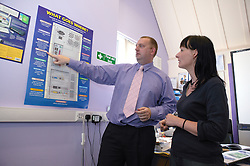 Man and Woman looking at a poster,