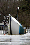 © Licensed to London News Pictures. 12/02/2014. Old Windsor, UK . A boat wedged against Bell Weir. Flooding in OLD WINDSOR in Surrey today 11th February 2014 after the River Thames burst its banks. The Environment Agency has issued 14 Severe Flood Warnings alone the Thames. Photo credit : Stephen Simpson/LNP