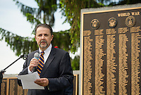 """Mayor Ed Engler speaks to the crowd of """"remembrance"""" during the Memorial Day service at Veteran's Square on Monday morning.  (Karen Bobotas/for the Laconia Daily Sun)"""