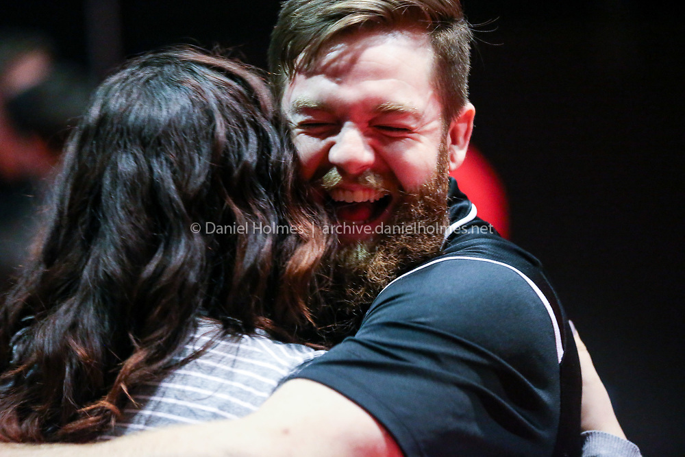 (1/9/19, ASHLAND, MA) Hopkinton assistant coach Tommy Karner hugs his sister Jessie Karner, 12-year Hopkinton wrestling manager, during the Coaches vs. Cancer wrestling match at Ashland High School on Wednesday. [Daily News and Wicked Local Photo/Dan Holmes]