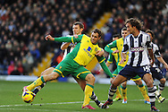 Norwich city's Johan Elmander looks to break into the box. Barclays Premier league, West Bromwich Albion v Norwich city at the Hawthorns in West Bromwich, England on Sat 7th Dec 2013. pic by Andrew Orchard, Andrew Orchard sports photography.