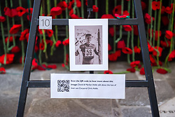 "© Licensed to London News Pictures. 27/10/2018. Bristol, UK. The Royal British Legion launch this year's Poppy Appeal, ""One thousand poppies, for one hundred years, for one million lives"" at Bristol Cathedral. Picture inside Bristol Cathedral of a commemoration for Corporal Chris Addis who was killed in Bosnia in 1998. For the launch of the 2018 Bristol Poppy Appeal at 11am on 27 October, The Royal British Legion recreated a scene from the end of WW1 outside Bristol Cathedral on College Green, and Colonel Clive Fletcher-Wood read the war poem In Flanders Fields. They were joined by a Bugler and the Bristol Military Wives Choir who performed songs from their new album 'Remember'. Staff at MOD Filton filled 400 sandbags with eight tonnes of sand to build trenches and recreate 'Flanders Fields' and planted over 1000 waterproof poppies on College Green. Poppies and sandbags can be sponsored by individuals wanting to remember those who fought and died in conflict. There were re-enactors in WW1 uniform from Somerset Light Infantry (known as the West Country Tommys), as well as medics and nurses with equipment from the time. Bristol's own 'War Horse' (Buzz from Blagdon Horsedrawn Carriages) was on College Green behind the improvised barbed wire to represent the 350,000 horses that left Avonmouth for the frontline during WW1. There are also 10,000 knitted poppies on display both in and outside Bristol Cathedral following 'The Charfield Yarn Bombers' incitement to locals to get knitting to mark the occasion, with a display inside the Cathedral organised by Helen Date. Photo credit: Simon Chapman/LNP"