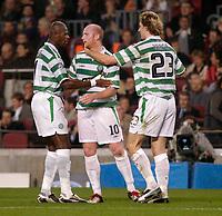 Fotball<br /> Foto: SBI/Digitalsport<br /> NORWAY ONLY<br /> <br /> Barcelona v Celtic<br /> UEFA Champions League. 24/11/2004.<br /> <br /> Celtic's John Hartson (C) celebrates his first half goal with Stanislav Varga (R) and Didier Agathe