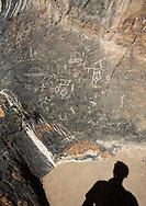 Self-portrait with petroglyphs, Death Valley, California