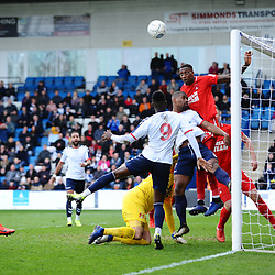 TELFORD COPYRIGHT MIKE SHERIDAN 23/3/2019 - Marvin Ekpiteta of Orient heads off the line during the FA Trophy Semi Final fixture between AFC Telford United and Leyton Orient at the New Bucks Head