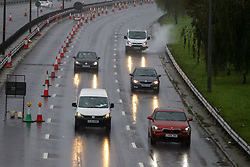 © Licensed to London News Pictures. 03/10/2020. London, UK. Vehicles drive through the rain and spray surface water on the A406 North Circular Road, in north London. The Met Office forecasts heavy rain and windy weather for the rest of the day in the capital. Photo credit: Dinendra Haria/LNP