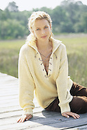 Catalog photograph of a cotton knit sweater, with a lowcut lace front, worn by Nicole, our fashion model for Boston Proper.