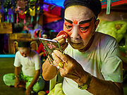 "26 FEBRUARY 2018 - BANGKOK, THAILAND: Performers put on their makeup before a Chinese Opera at the Phek Leng Shrine in the Khlong Toey section of Bangkok. The shrine traditionally hosts a Chinese Opera just after the end of Lunar New Year festivities. Thailand is home to the largest population of overseas Chinese in the world, and Chinese cultural practices, like Chinese opera, called ""ngiew"" in Thailand, are popular. Many of the performers are ethnic Thais who don't speak Chinese. They learn their lines phonetically.     PHOTO BY JACK KURTZ"