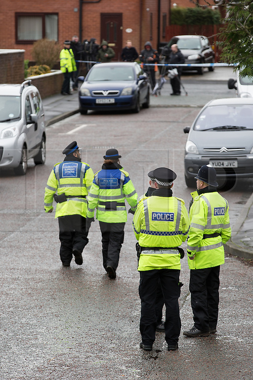 © Licensed to London News Pictures . 11/02/2014 . Blackburn , UK . Police officers at the scene . Police and forensic examiners on Emily Street in Blackburn at the scene where an eleven month old baby girl was mauled to death late last night (10th February 2014) . Photo credit : Joel Goodman/LNP