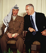 Washington DC 1996/12/24 Arafat and Israeli Prime Minister Benjamin Netanyahu at a Middle Conference.  Photo by Dennis Brack