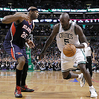 10 May 2012: Boston Celtics power forward Kevin Garnett (5) drives past Atlanta Hawks Erick Dampier (25) during the Boston Celtics 83-80 victory over the Atlanta Hawks, in Game 6 of the Eastern Conference first-round playoff series, at the TD Banknorth Garden, Boston, Massachusetts, USA.