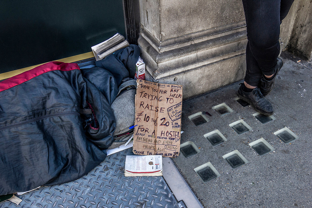 Homeless person sleeping on streets of London, UK.