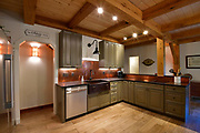The kitchen adjoins the main open living area on the first floor of the home of Steve and Jennifer Schatz. The open-concept home is designed to resemble a Missouri dairy barn. <br /> Photo by Tim Vizer