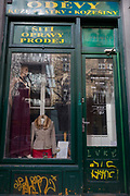 A traditional Czech womens clothing fashions and repairs shop window in the Holesovice district, Prague 7, on 20th March, 2018, in Prague, the Czech Republic.