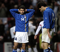 Fotball<br /> VM-kvalifisering<br /> England v Azerbaijan<br /> St. James` Park - Newcastle<br /> 30. mars 2005<br /> Foto: Digitalsport<br /> NORWAY ONLY<br /> Azerbaijan's Rashad Sadigov (L) cannot believe it as their stout resistance is finally ended as England celebrate in the background