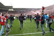 Middlesbrough fans invade the pitch after securing promotion during the Sky Bet Championship match between Middlesbrough and Brighton and Hove Albion at the Riverside Stadium, Middlesbrough, England on 7 May 2016. Photo by Simon Davies.
