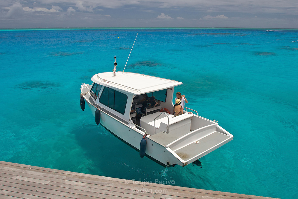 A lagoon shuttle boat leaves the Bora Bora Nui Resort & Spa for the town of Vaitape. Previously a Starwood Luxury Collection property, the Bora Bora Nui is now operated by Hilton. Bora Bora is one of the Leeward Islands in the Society Islands archipelago of French Polynesia.