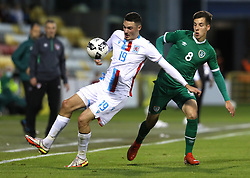 Luxembourg's Edin Osmanovic (left) and Republic of Ireland's Conor Noss battle for the ball during the UEFA Under-21 Championship Qualifying Round Group F match at the Tallaght Stadium, Dublin. Picture date: Friday October 8, 2021.