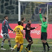Referee's Mustafa Ogretmenoglu show the red card to Eskisehirspor's Abdulaziz Solmaz (2ndR) during their Turkey Cup matchday 3 soccer match Eyupspor between Eskisehirspor at Eyup Stadium in Istanbul Turkey on Wednesday, 11 January 2012. Photo by TURKPIX