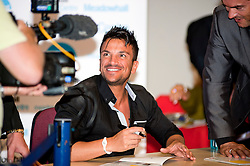"""Peter Andre Signs copies of his new childrens books """"The Happy Birthday Party"""" and """"A New Day at School"""" in WH Smiths Sheffield while being filmed for his TV show .6th September2011 Image © Paul David Drabble"""