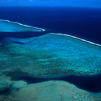Oceania, South Pacific, French Polynesia, Tahiti, Bora Bora. Aerial view of the reefs along the coast of Bora Bora.