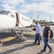 CAPTION: Dr Sá and Dr Neto prepare to board the plane the government has hired for them to travel to Tabatinga. LOCATION: Eduardo Gomes International Airport, Manaus, Amazonas, Brazil. INDIVIDUAL(S) PHOTOGRAPHED: Dr Álvaro Sá (left) and Dr Joaquim Neto (right).