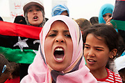 Tunisia 2011. Remada camp for refugees from Libya. After Friday prayers refugees (mostly mothers and children) held a demonstration around the camp. Young girl shouting.
