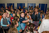 """Gilford Elementary students and faculty proudly ring the """"bell"""" after being named the 2018 EDies Elementary School of Excellence on Thursday morning.  (Karen Bobotas/for the Laconia Daily Sun)"""