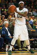 WACO, TX - JANUARY 24: Royce O'Neale #00 of the Baylor Bears drives to the basket against the Oklahoma Sooners on January 24, 2015 at the Ferrell Center in Waco, Texas.  (Photo by Cooper Neill/Getty Images) *** Local Caption *** Royce O'Neale