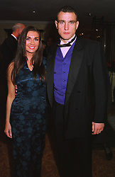 MR & MRS VINNIE JONES he is the international footballer, at a ball in London on 17th December 1997.MEG 26